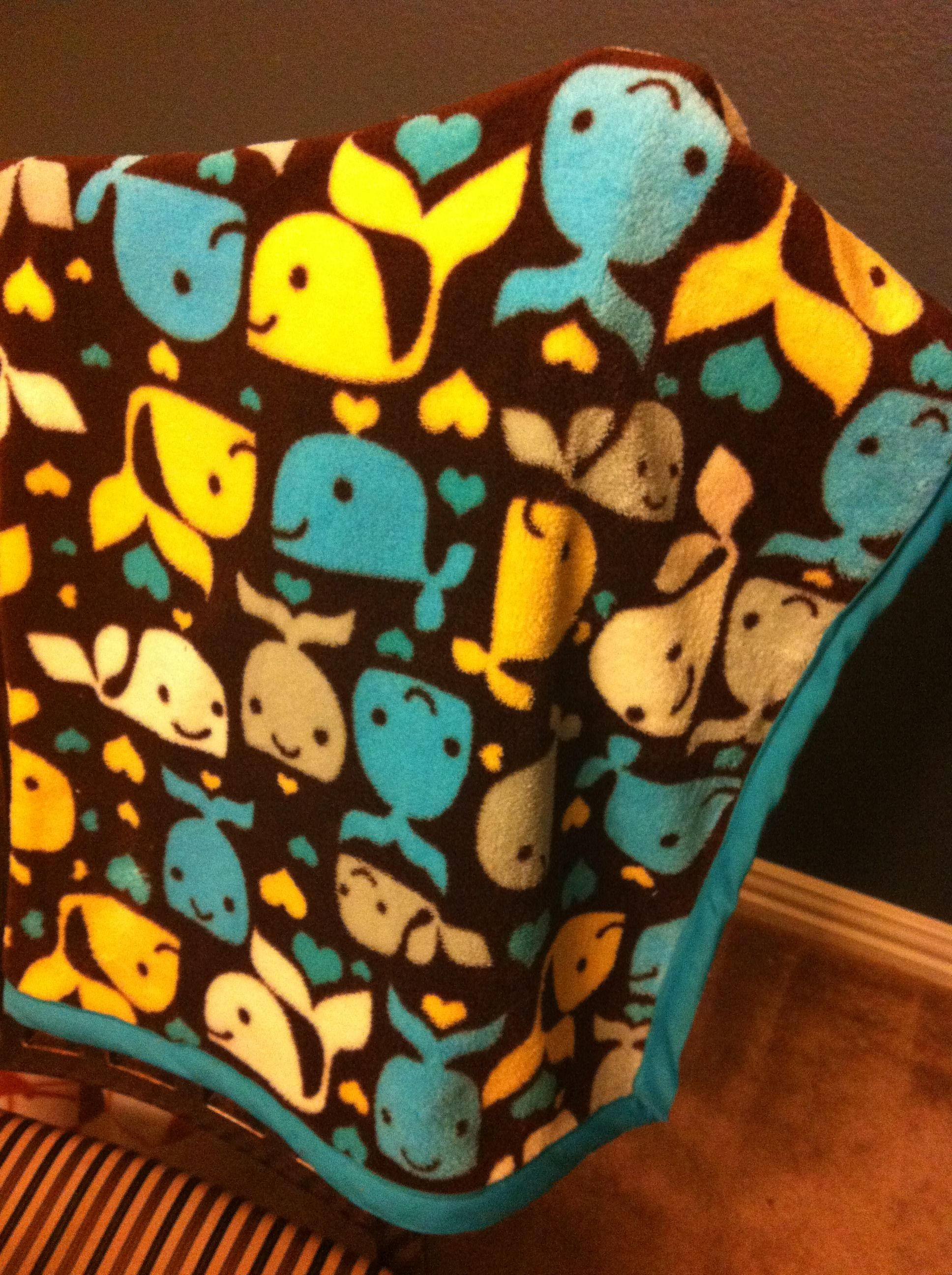Super cute whale fabric from Joann's. Turquoise binding from Hobby Lobby.