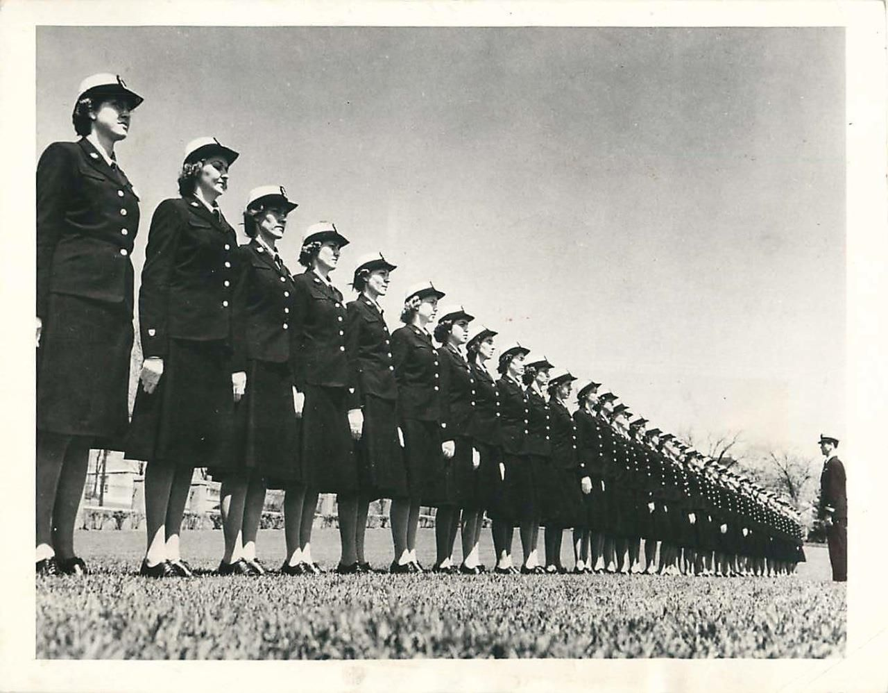 """Original Press Caption: """"NEW LONDON, CONN - With chins up, SPAR cadets stand inspection at the U.S. Coast Guard Academy where they are undergoing an indoctrination course preparatory to becoming officers in the Coast Guard Women's Reserve."""" June 29, 1943. Official US Coast Guard Photo."""