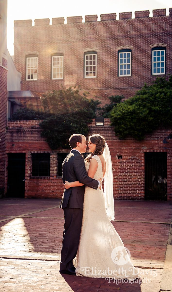 A still moment in a bustling Downtown. The Galley Alley is a favorite location for unique wedding photos. Courtesy of Elizabeth Davis Photography http://www.elizabethdavisphoto.com/index2.php#/home/