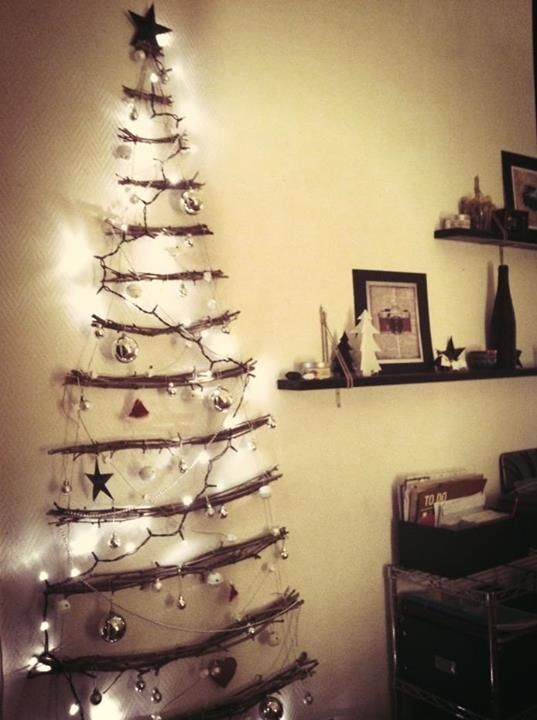 Our Christmas Tree this year. Made from an old pallet - stuck to the ...