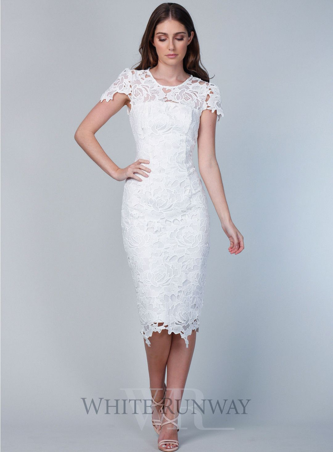 e8cd6d3d86b4 Jolie Lace Dress. A beautiful midi length dress by Romance the Label. A  sheer lace high neck style featuring cap sleeves and an assymetric skirt  hemline.
