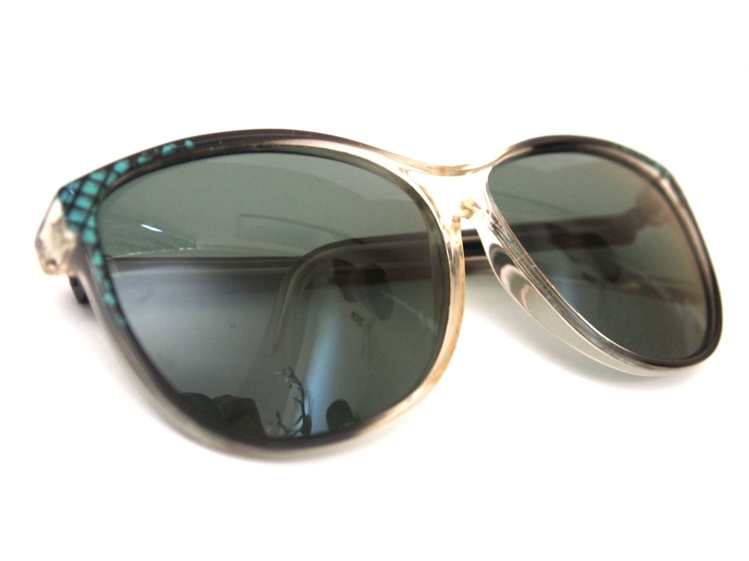 vintage clear, black and turquoise sunglasses. $25,00, via Etsy.