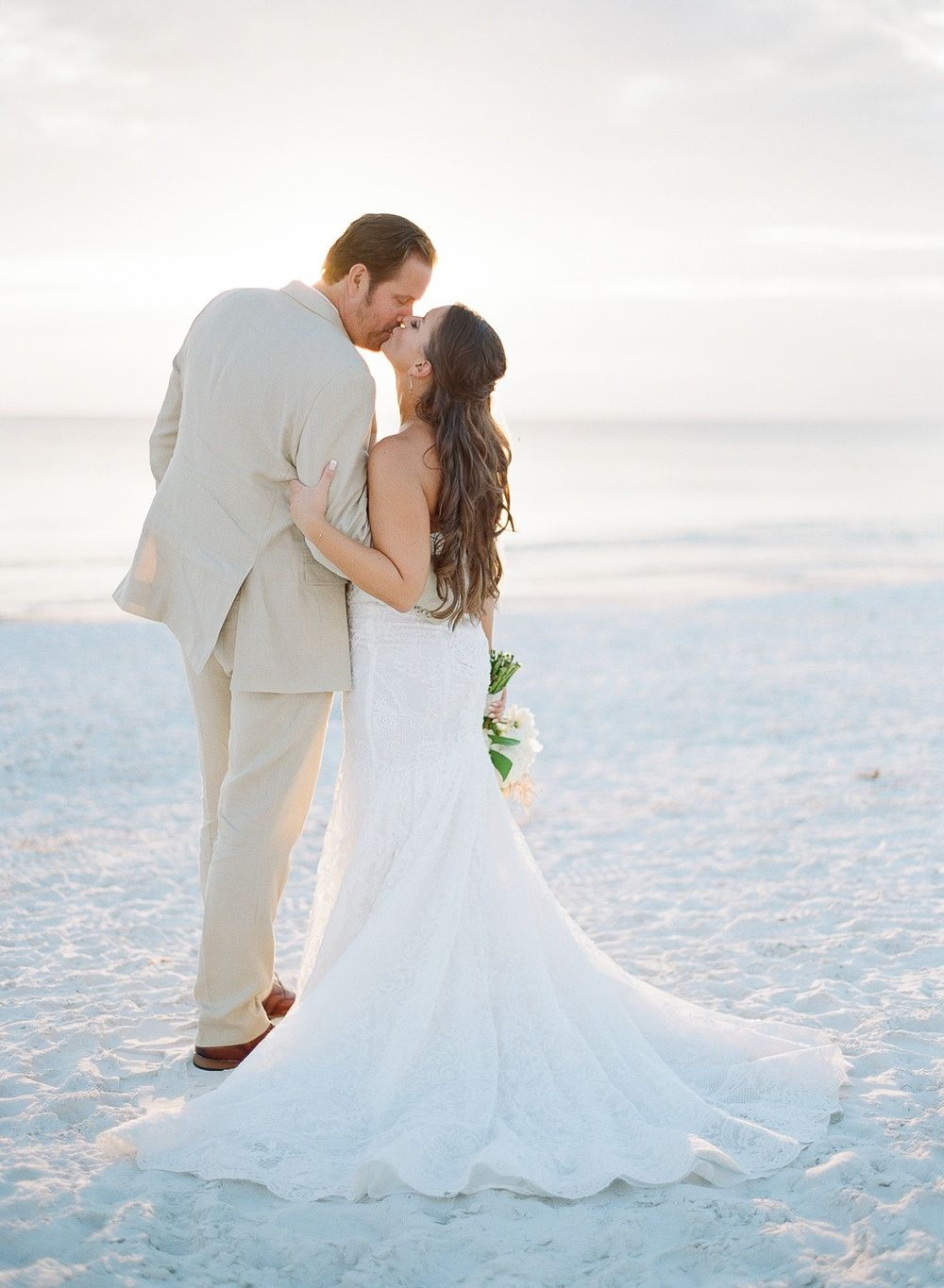 Tropical florida wedding on st pete beach with monstera leaves