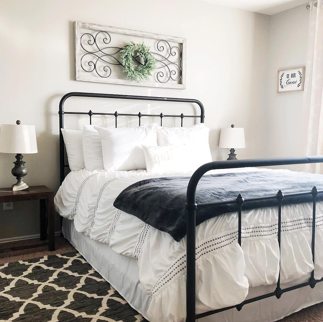 Farmhouse Bedroom With Rod Iron Bed Bedroom Pictures Above Bed