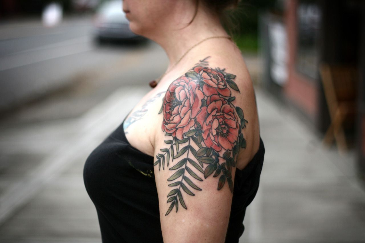 Alice carrier is a tattoo artist at wonderland tattoo in