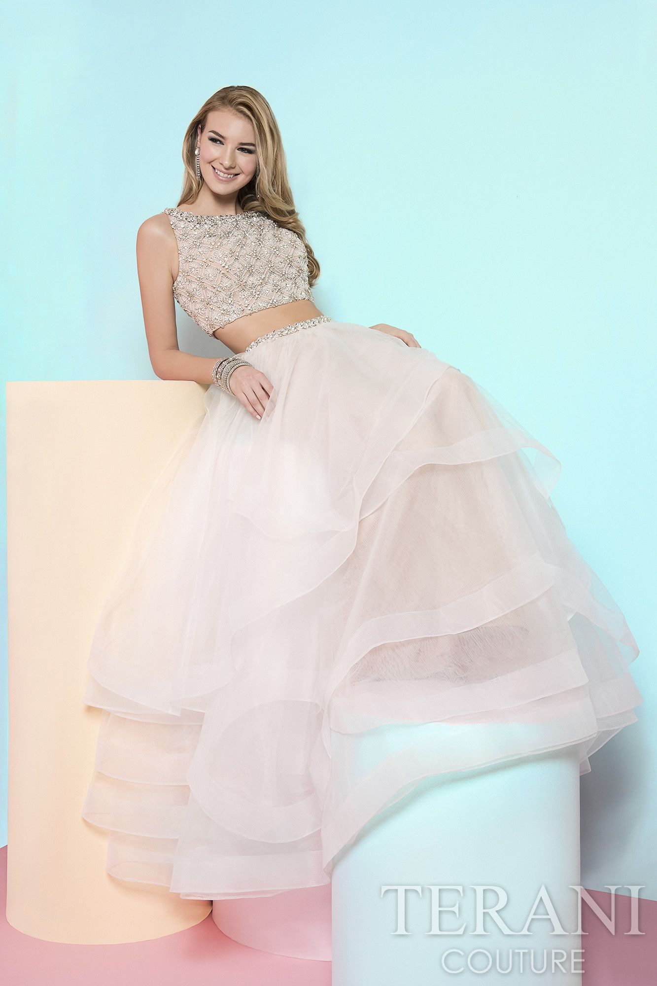 Two piece prom gown with beaded crop top this prom dress is