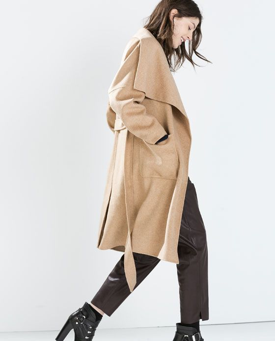 7b86dc5a10ef0 Z A R A Long wool camel coat. Straight cut and long sleeves with dropped  shoulder. Crossover cape-effect collar and belt.