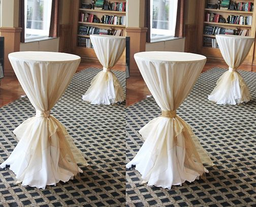 Ivory Highboy Table Linens Covered In Gold Organza Overlays With Gold Satin Sash What A Statemen Cocktail Table Decor Wedding Table Setup Wedding Table Linens
