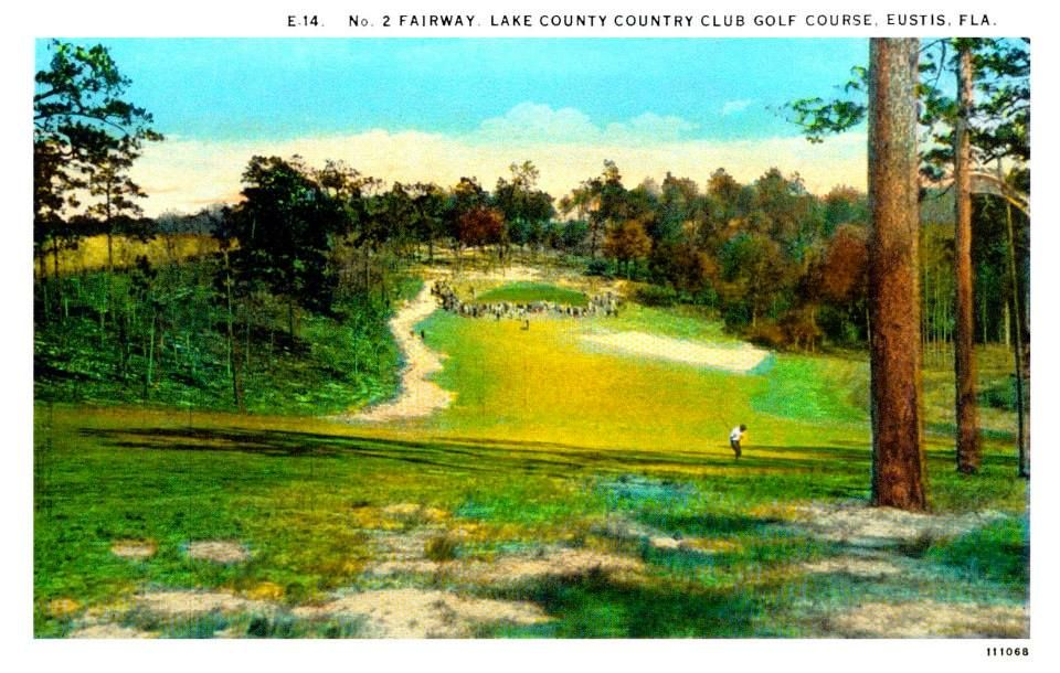 In this view, you are looking at the No. 2 fairway of the Lake County Country Club's golf course. The tee for this fairway was just east of the intersection of Country Club Drive and Country Club Road; the fairway ran east to the green beyond the north side of Lake Alfred.