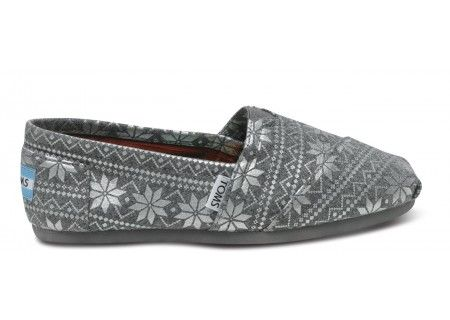 e268a2a6f05 a pair of silver holiday womens classic toms slippers with every pair  purchased toms gives a
