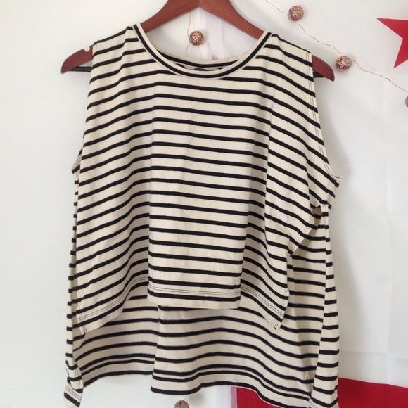 Free People muscle tank Free People striped muscle tank. High side slits. Crop front. Brand new never worn Free People Tops Muscle Tees