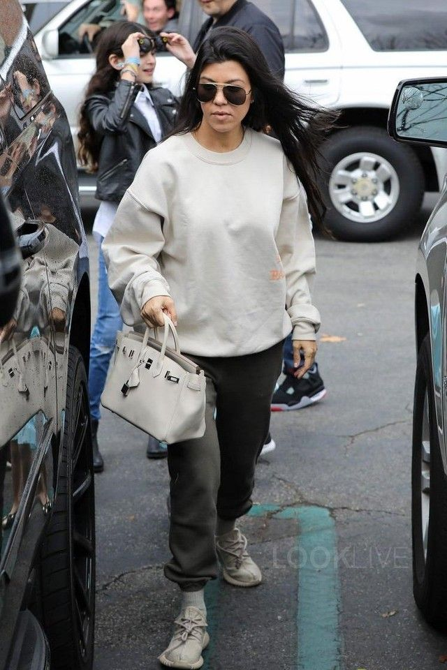 667252030477b2 Kourtney Kardashian wearing Hermès Birkin Bag, Adidas Yeezy Boost 350  Sneakers