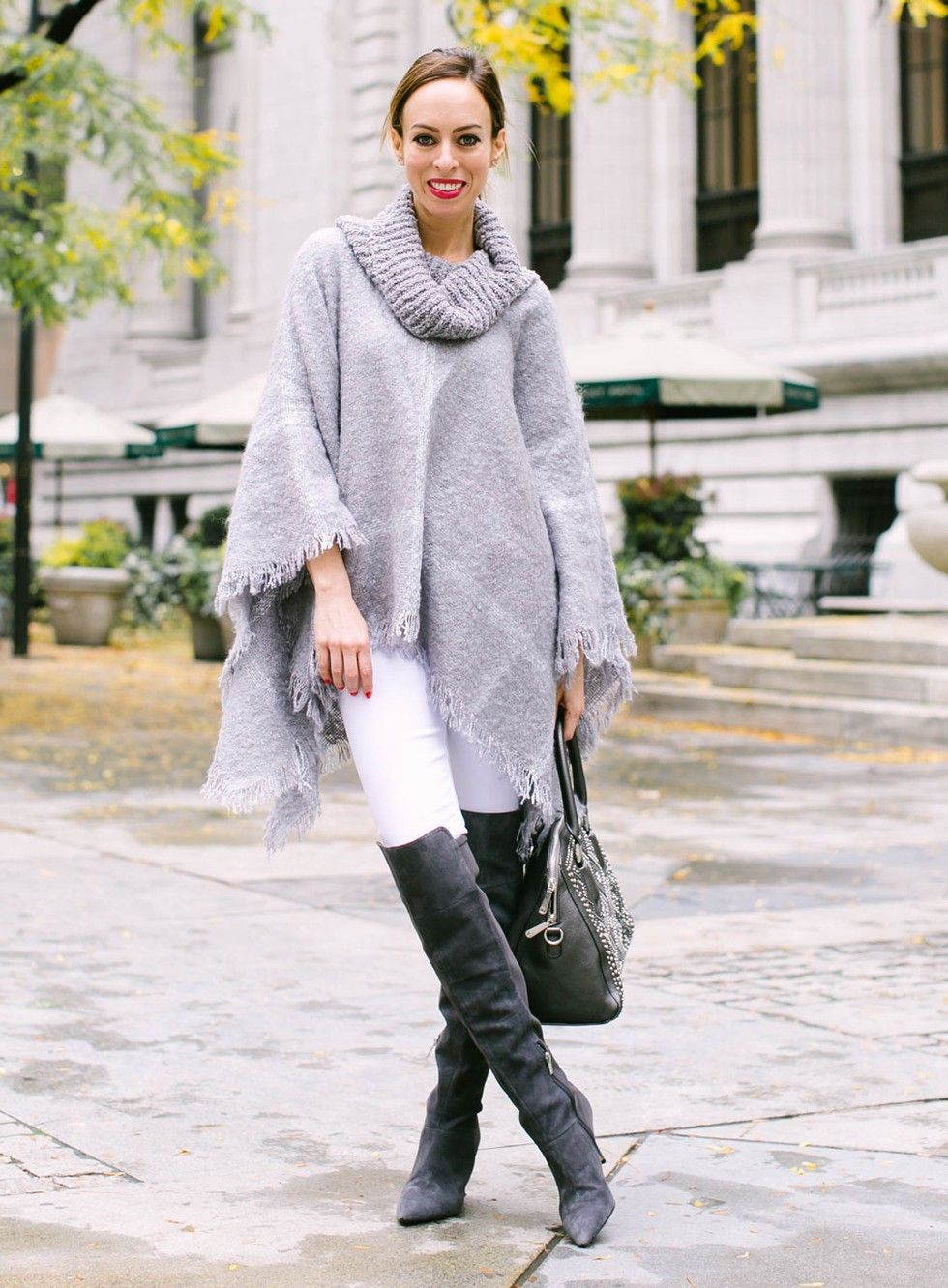 White Jeans, over the knee boots and poncho.