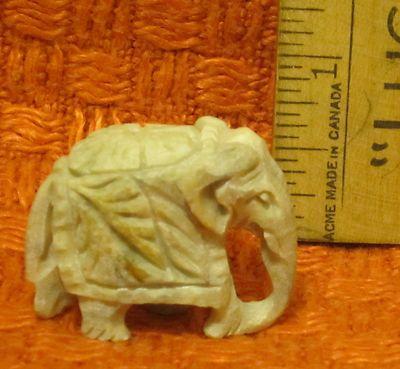 Very nice miniature carved soapstone Asian Elephant figurine w/flower and leaf howdah