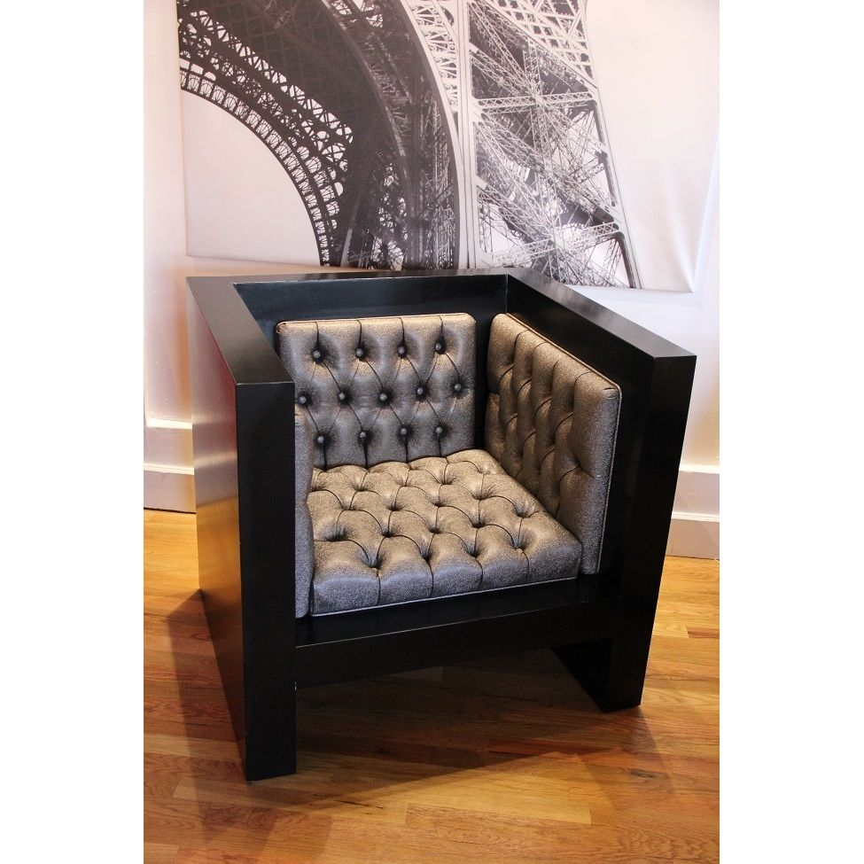 Showcasing a modular design with a sleek, angular solid wood frame finished in glossy black. Complemented by grey vinyl upholstery with deep button tufting on inner seat, back and sides, this contemporary chair is sure to make a statement.