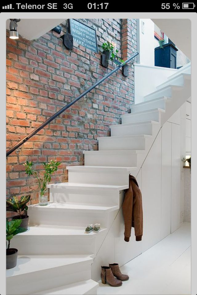 The painted stairs, and the rail would look great in the stairway at the new house!  A brick wall inside makes a very warm impression.