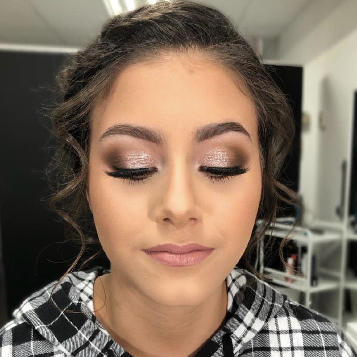 Photo of Prom makeup. Dark hair. dark eye color. Eye makeup. Light Nude lipstick. Sparkly…