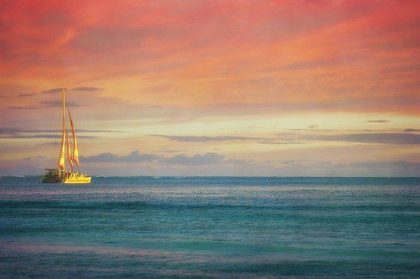 A Sailboat In The Tropical Waters Off Print By Roberta Murray