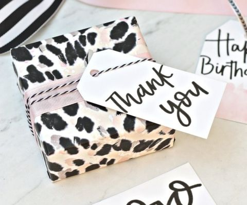Free printable hand lettered gift tags and leopard print gift wrap.