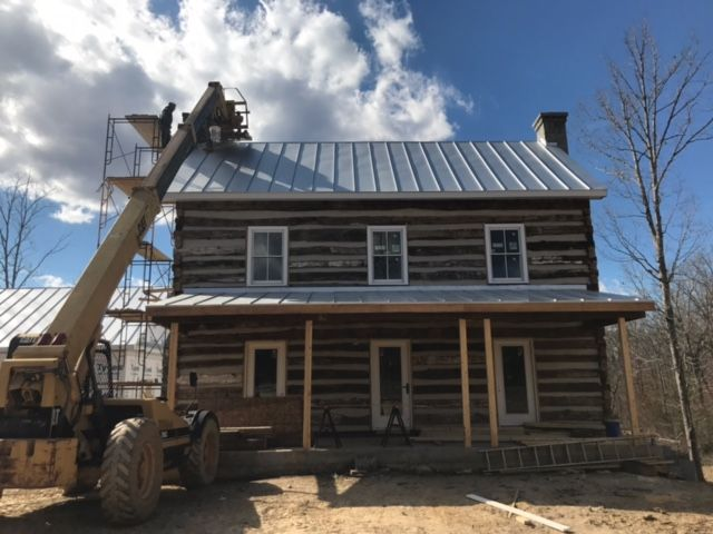 Metal Roof going on the log home in Charlottesville