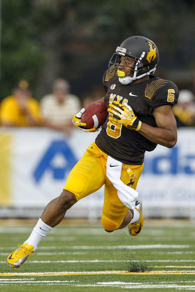 2013 Wyoming Brown On Gold Uniform With Matte Helmet Wyoming