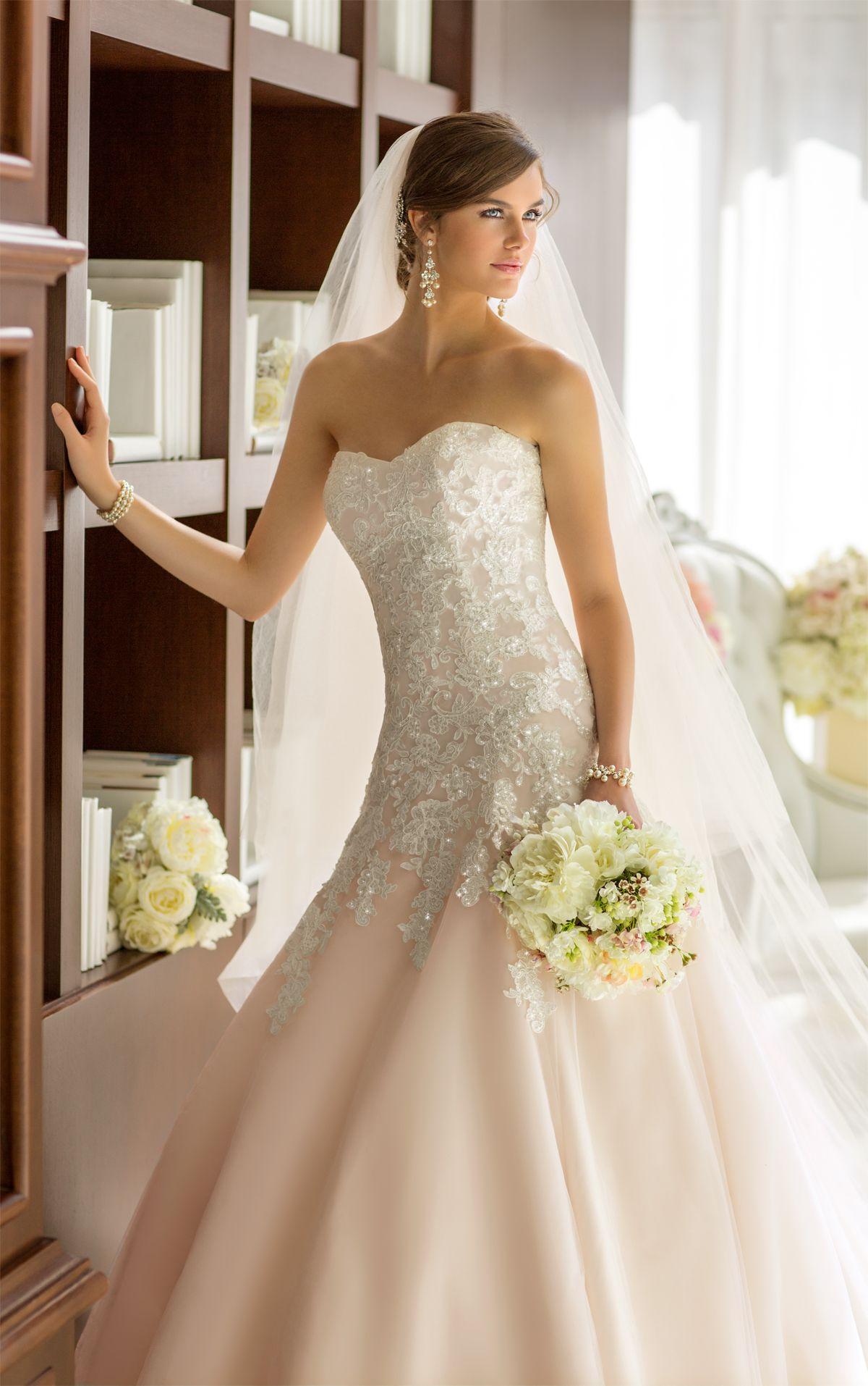 Flattering wedding dresses for plus size  This elegant Essense of Australia beaded wedding dress features
