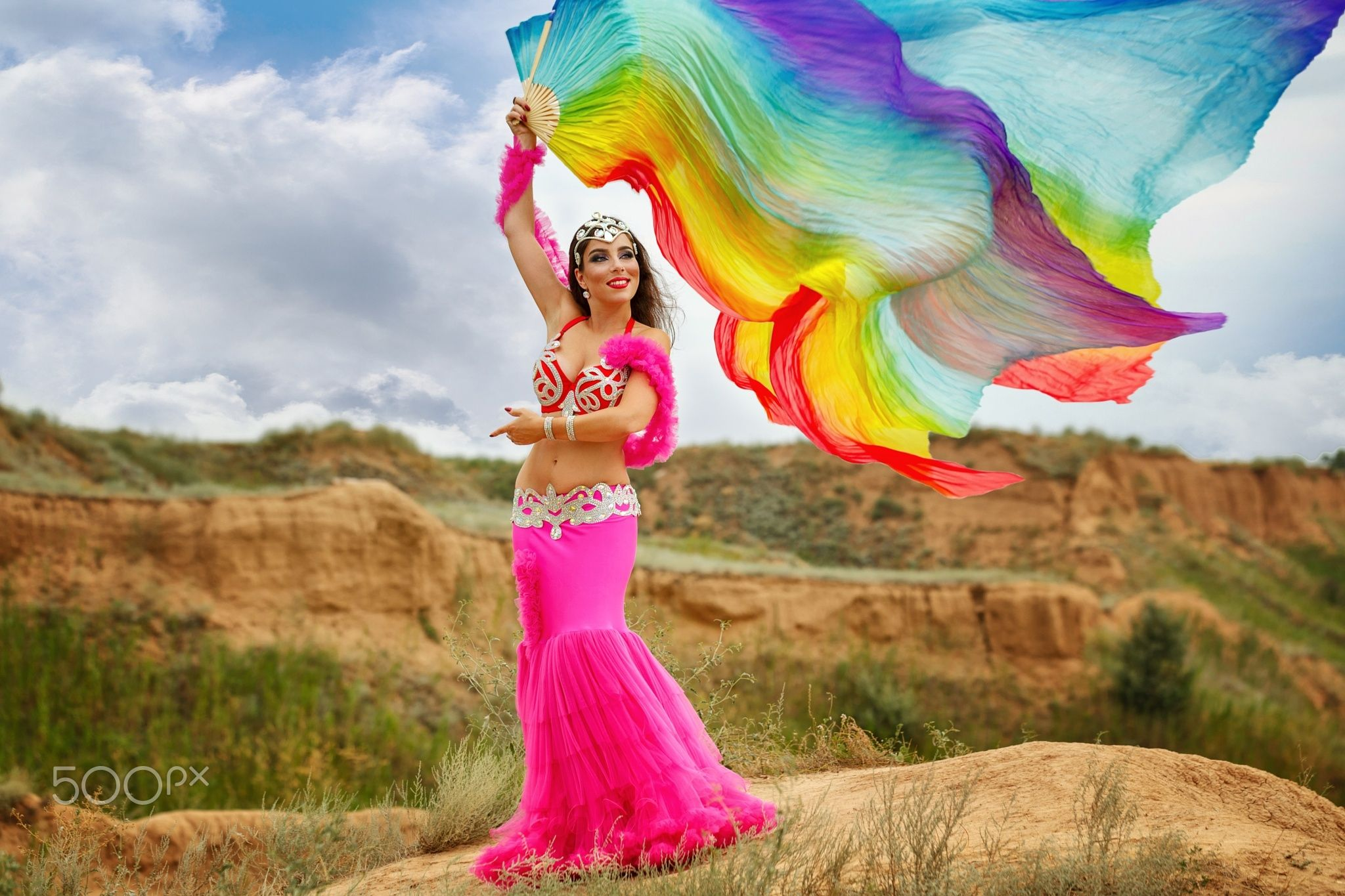 Girl dancing belly dance with a shawl - Oriental Beauty belly dancer. Nice girl in national dress dancing with shawl outdoors. Nomads.