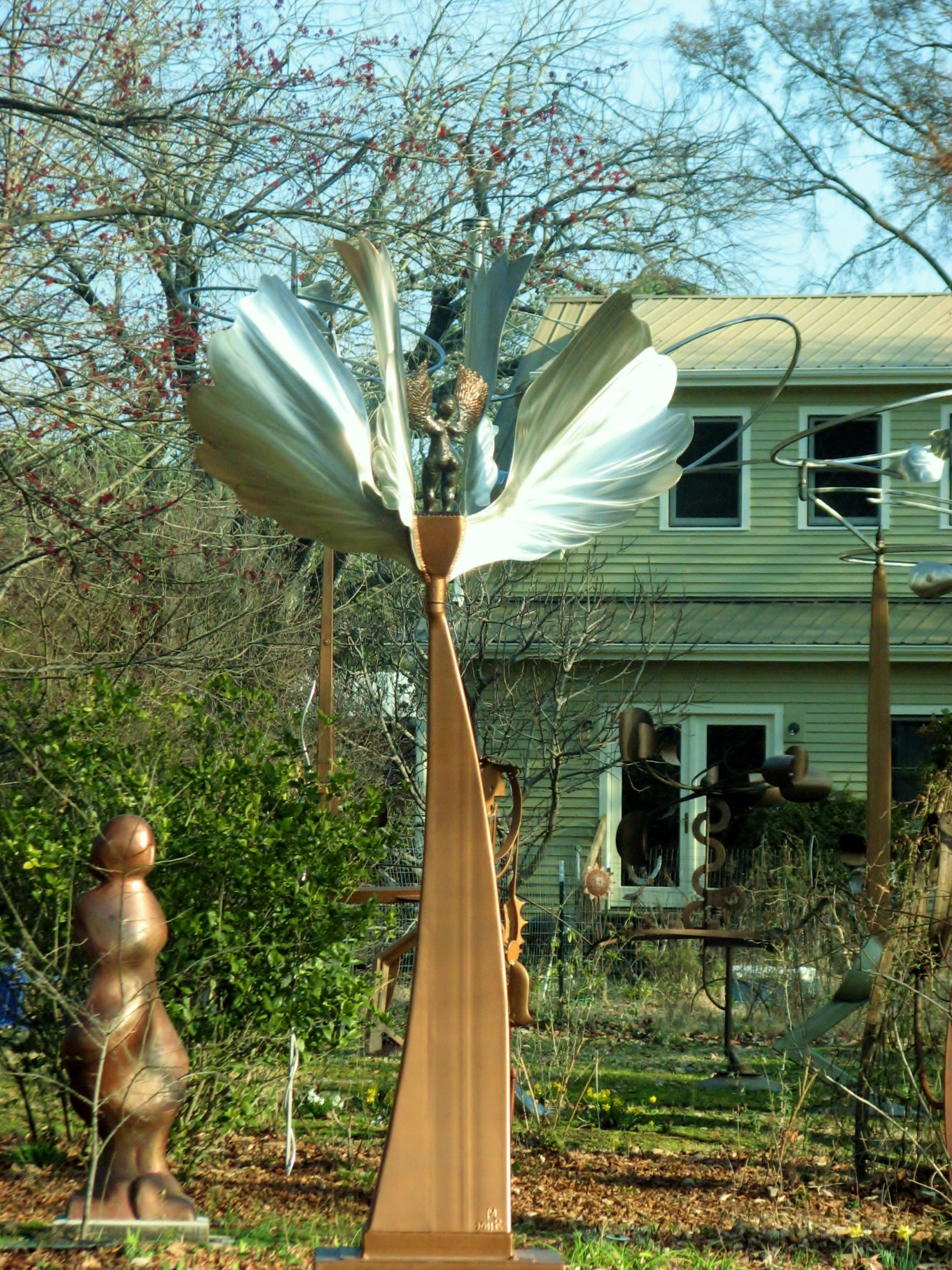 Angel Spinning In The Wind Metal Sculpture In Carrboro Nc