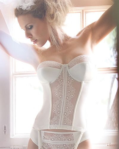 Gorgeous bridal basque, love the uniqueness of this lace detail.