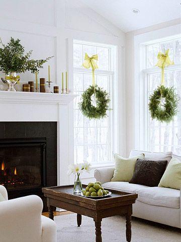 like idea of hanging fresh wreaths on inside of window, pretty mantle