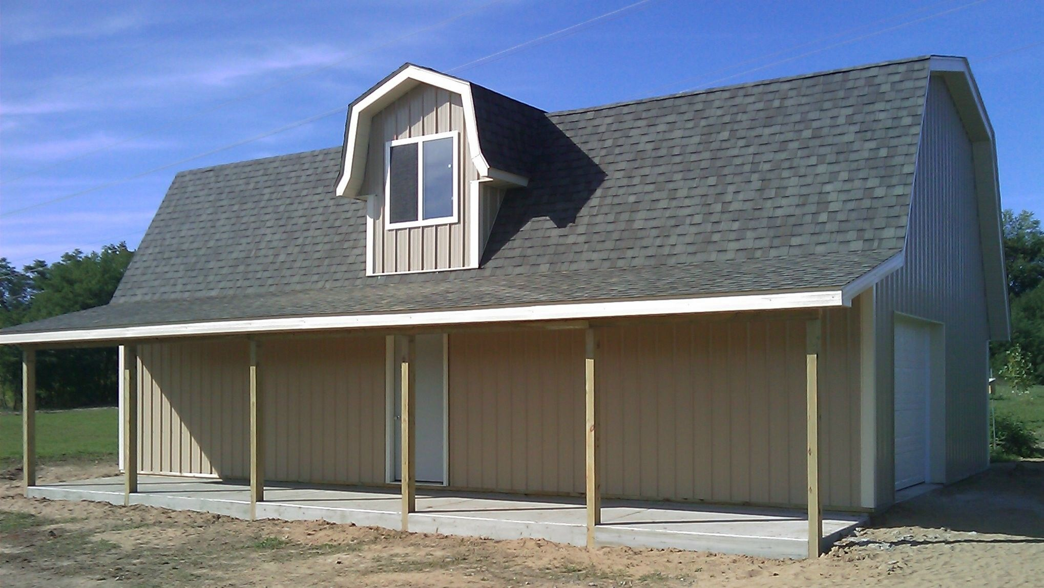 Pole barns pole barns omni builders about us michigan for Pole construction homes