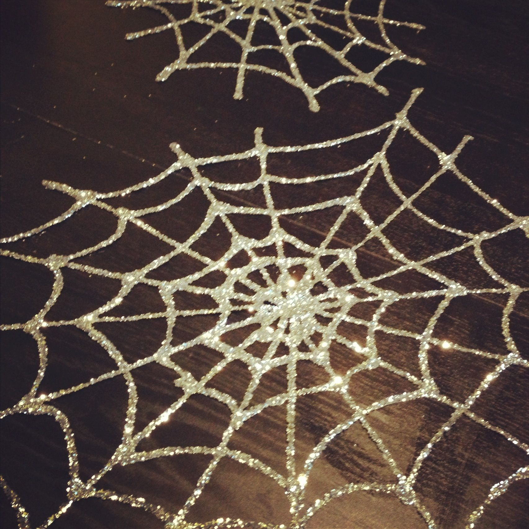 DIY Spider Web with glue and glitter on wax paper