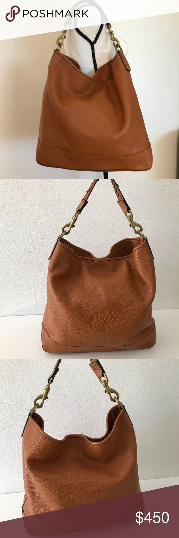 "Mulberry Effie Large Tote Oak Color Authentic Mulberry Effie Large Tote In beautiful oak color  Soft leather hobo with braided handle detail  Gold hardware  Excellent Preowned condition only has a ink stain inside very minor scuff bottom corner of purse  W 17"" L 14"" D 4 1/2"" Mulberry Bags Hobos #mulberrybag"