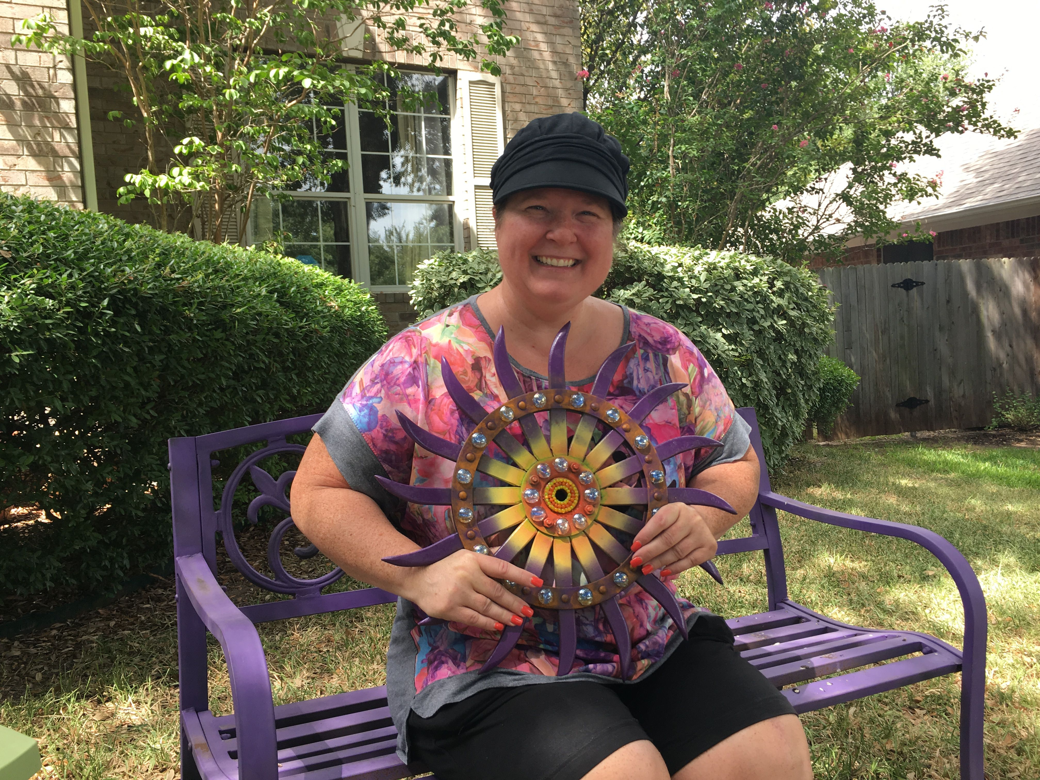 A happy customer with her new rotary hoe garden art!