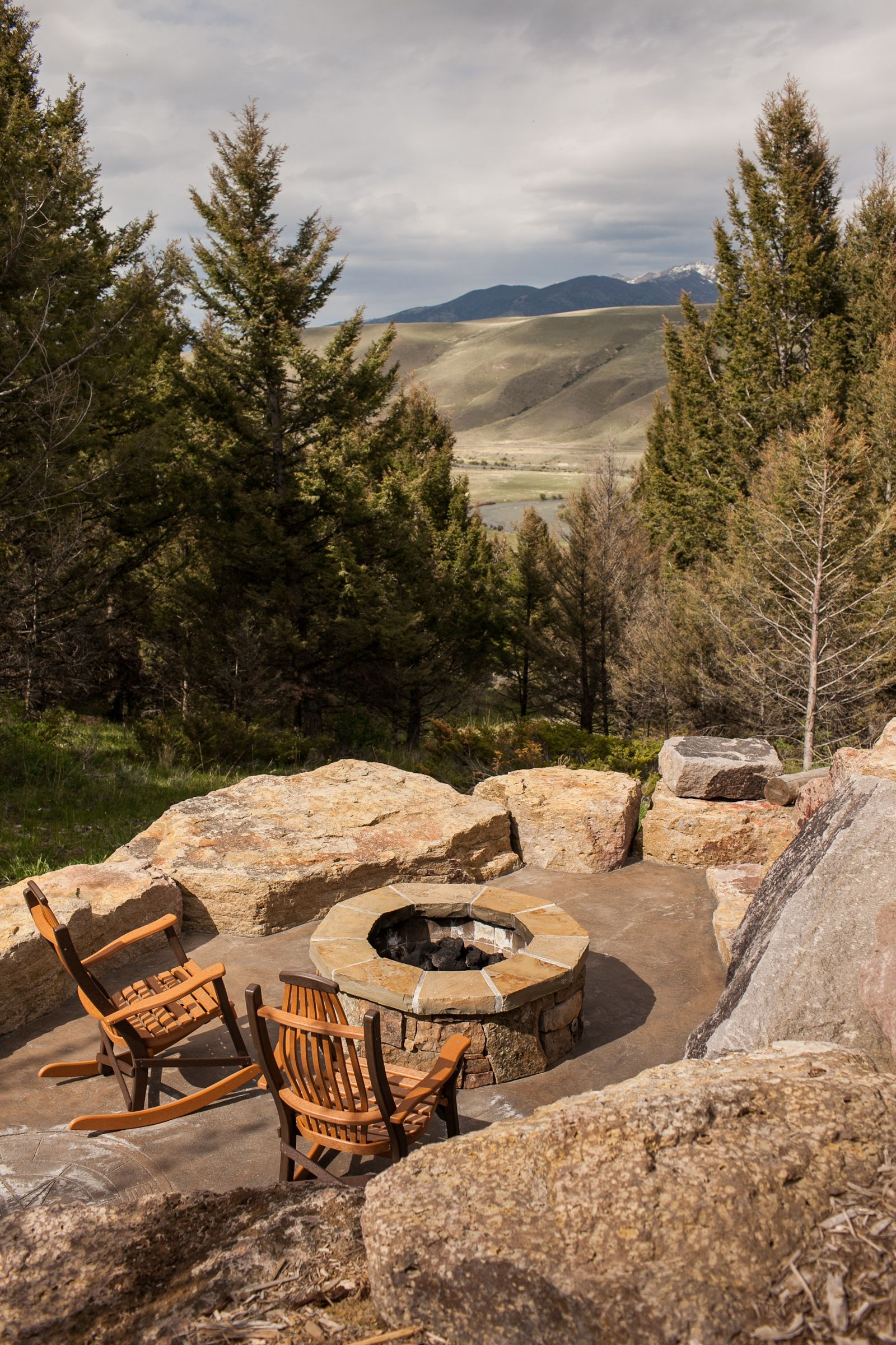 outdoor fire pit over looking the madison river sun west ranch
