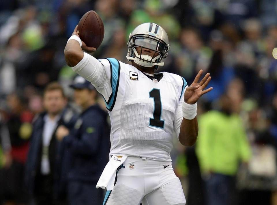 Carolina Panthers' Cam Newton (1) throws downfield during pre game against the Seattle Seahawks at CenturyLink Field on Sunday, October 18, 2015.
