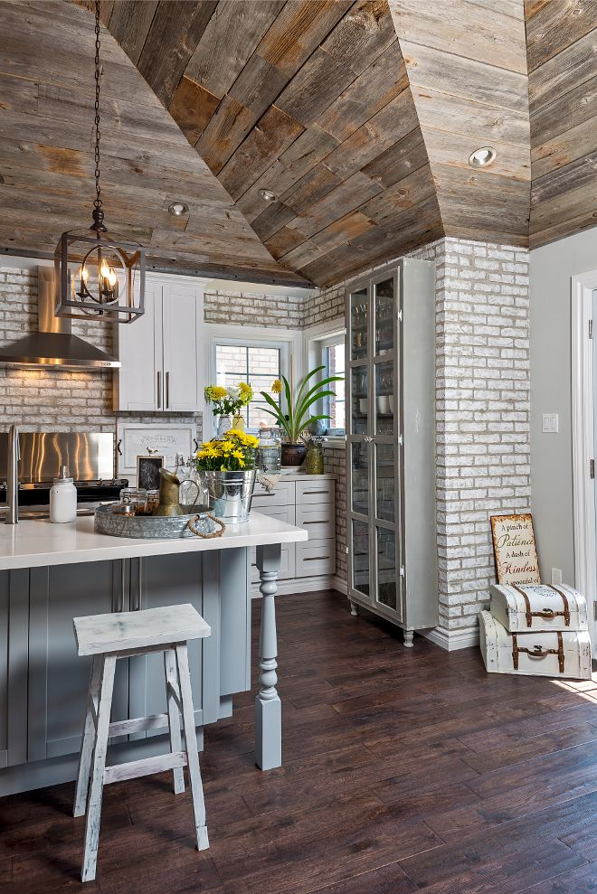 Farmhouse Kitchen With Whitewashed Brick Wall, Reclaimed Wood Shiplap And  Grey Island.
