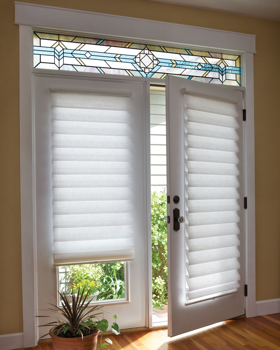 Roman Shades Are Soft Fabric Window Treatments That Hang Flat Against The Window When In The French Door Window Treatments Door Coverings Patio Door Coverings