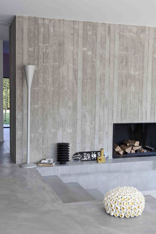 vertical board-formed concrete at minimalist fireplace // Hart ...