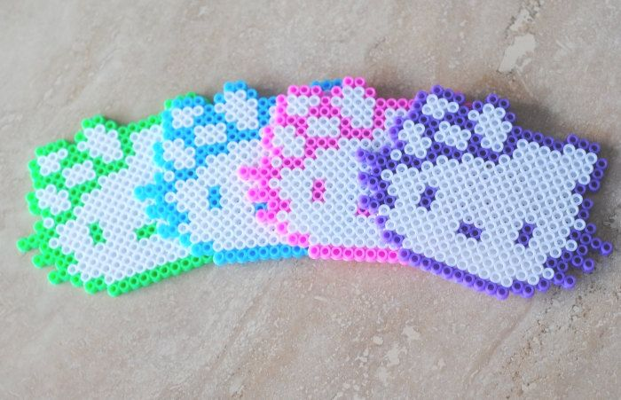 4 Piece Hello Kitty Coaster Set. $25.00, via Etsy. Or make them yourself. I think the bow needs to be an accent color
