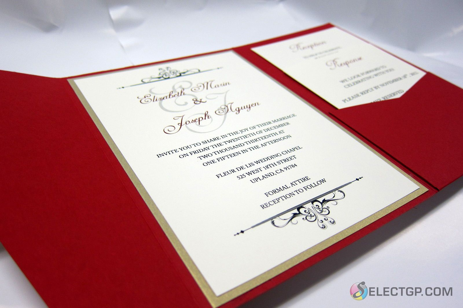 Red pocket invitation with invitation card and cards in flap at ...