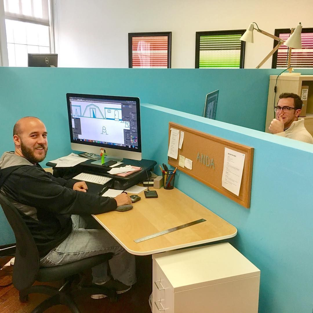 A couple of great designers working on some great designs for our great clients. Isn't it great?