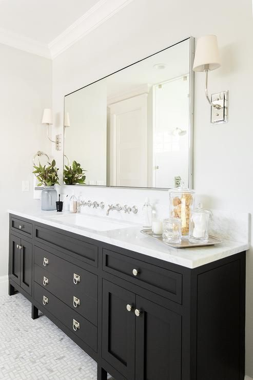 A Gorgeous Black Bathroom Vanity Sits On Maze Marble Floor Tiles And Is Fitted With Polished Nic Black Vanity Bathroom Farmhouse Bathroom Decor Bathroom Design