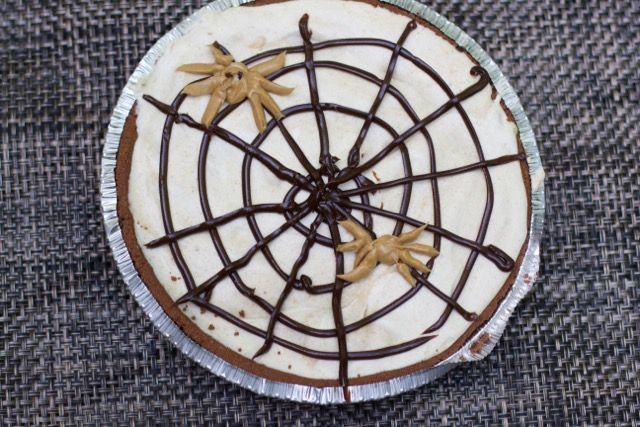 Create this super easy last minute Halloween Dessert. A chocolate peanut butter Ice Cream Pie is sure to be a crowd pleaser. Adorn the top with an edible spider web and peanut butter spiders.