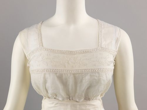 19th century tucker (cover up under a low-cut dress) on omgthatdress.tumblr.com