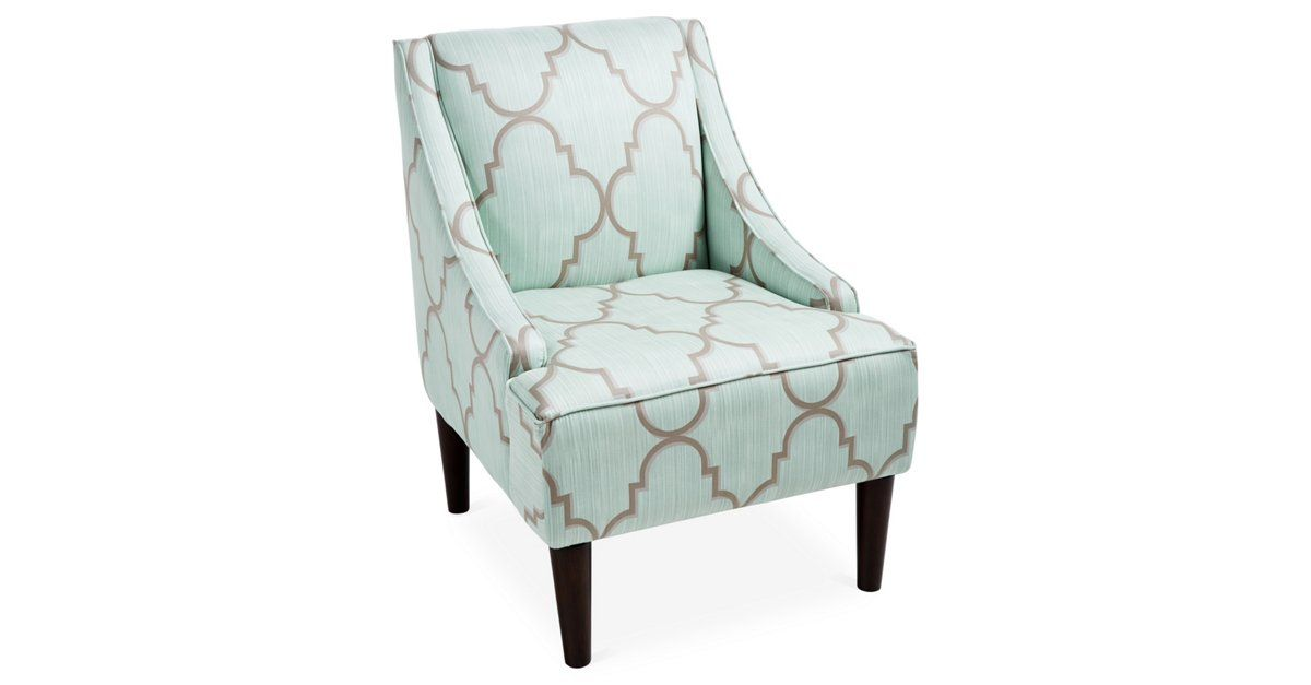 This swoop-arm chair features cheerful cotton upholstery and a slim, streamlined design. Ample foam padding ensures long-lasting comfort. Handcrafted in the USA.