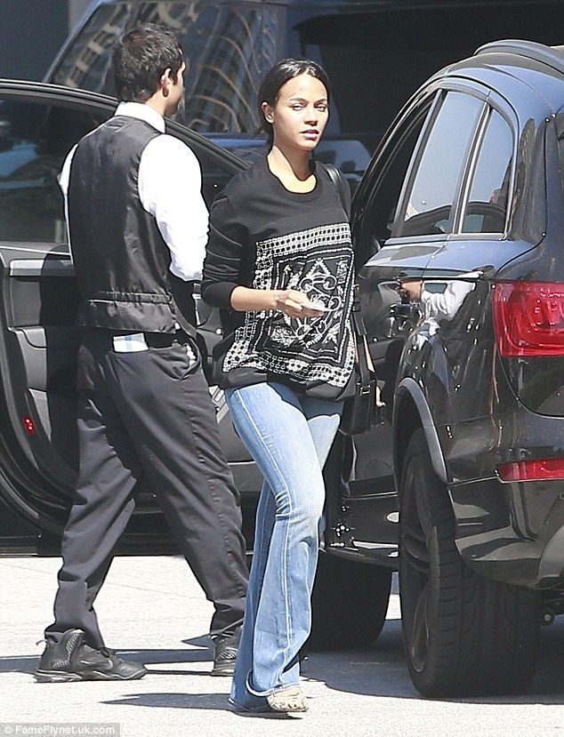 Casual Tuesday: Make-up free Zoe Saldana wears flared jeans and loose jumper in LA