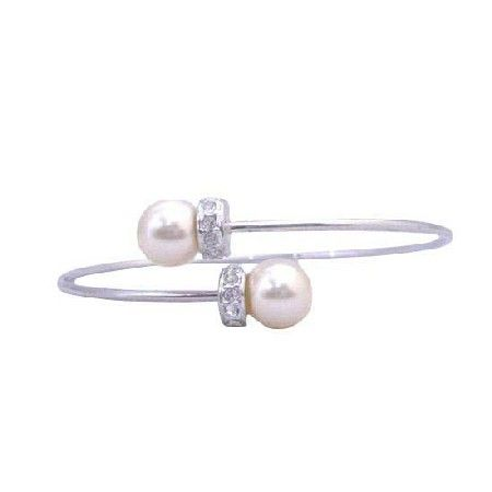 Price :$8.99 Soothing Pearls Jewelry Swarovski Cream Pearls Wire Bracelet Rondells Material : 7mm Genuine Swarovski Cream Pearls with silver rondells  Bracelet Length : 7 inches diameter  Bracelet Type : Wire cuff comfortable fit to your wrist