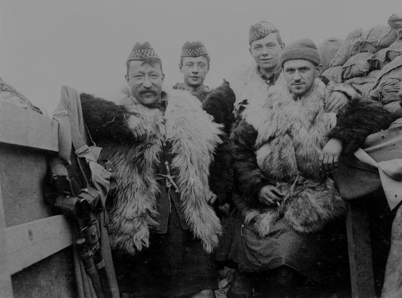 2nd Battalion, Argyll and Sutherland Highlanders, 19th Brigade, 6th and 27th Divisions, Bois Grenier Sector, March-June 1915. A group of men wearing Government issue fur jackets.