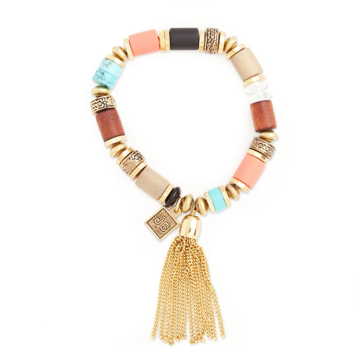 Stylish and imaginative describes this fabulous stretch bracelet from Jenny Bird featuring colored stones and beads, gold-tone discs and her signature gold-tone tassel. - Goldtone metal, stones,beads